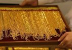 Gold tops Rs 27,000-mark on global cues, seasonal demand
