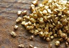 Gold extends losses on global cues, sluggish demand