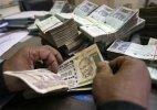 Rupee hits 2-week low of 64.01 vs dollar, down 3 paise