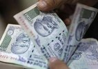 Rupee breaches 64-mark, hits 20-month low against dollar