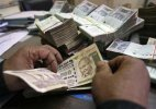 Rupee slips from initial gains, drops 15 paise against dollar