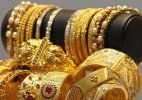 Gold declines on weak global cues, low demand