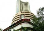 Sensex gives up early gains, trips 27 pts