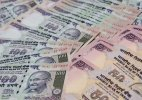 Rupee slips 7 paise against dollar
