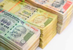Rupee hits life-time low of 60