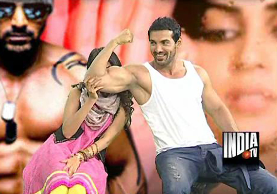 John Abraham Flexes His Biceps In India TV Studio