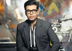 Single, unmarried Karan Johar announces his heir. Hint: She is an actress