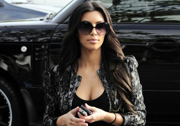 Kim Kardashian Shows Off Ample Cleavage Even At Kids' Event