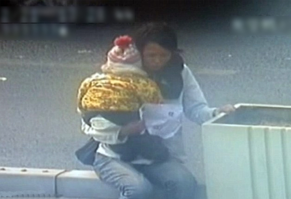 CCTV Footage Of Chinese Cop Saving Woman & Kid Trying To Jump Off Bridge