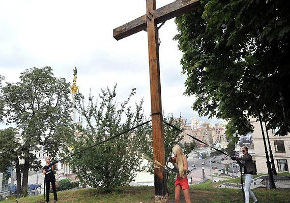 Cross-chopping topless activist flees Ukraine