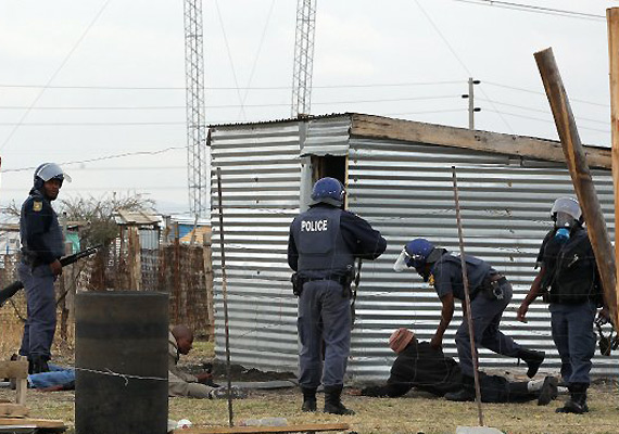 SAfrican police fire gas, force people into shacks