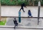 Charlie Hebdo attack: Cop killed on pavement identified as Ahmed Merabet