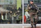 Brussels schools reopen, manhunt ongoing for Paris suspects