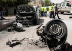 Two separate car bombs in parking lots kill 10