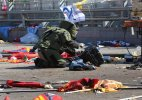 Ankara twin blasts kill at least 86, Turkish PM suspects suicide