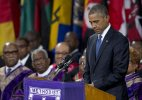 Obama delivers race lecture at church shooting eulogy