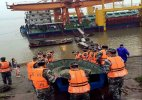 Chinese passenger ship with 458 aboard sinks in storm, 20 rescued