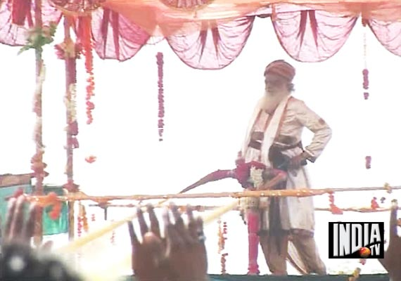 Self-styled godman Asaram Bapu again wastes lakhs of litres of water spraying on devotees in Surat
