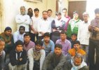 Cramped in a dingy room, Indian workers dream to get back home