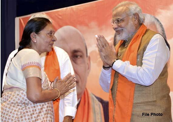 Modi Wishes Gujarat cm on Birthday Modi Wishes Gujarat cm on Her