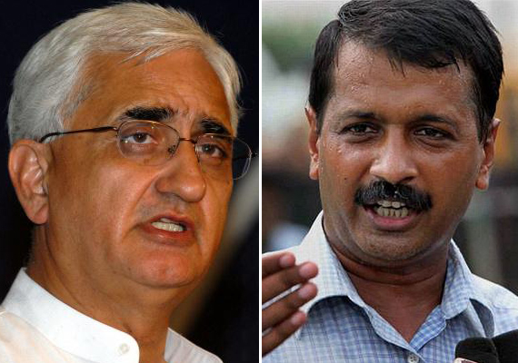 Khurshid returns to Delhi, vows to fight back legally