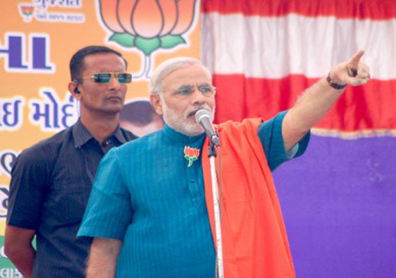 Narendra Modi unveils BJP's Gujarat manifesto