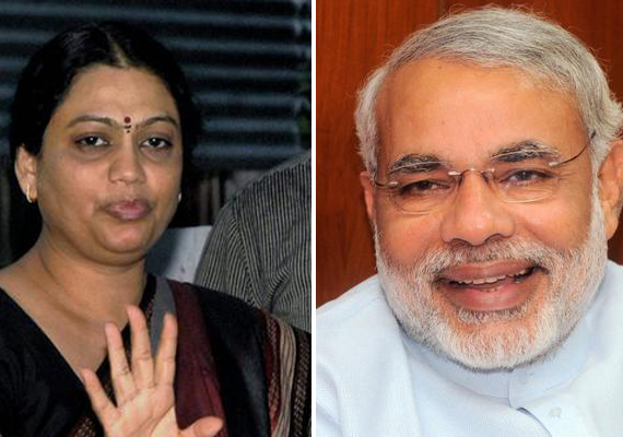 Modi files nomination at Vijay Mahurat, Congress fields suspended IPS officer's wife against CM