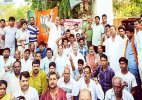 BJP staged dharnas demanding arrest of IPS officer