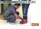 Bengal minister gets security guard to tie his shoes