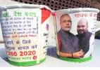 BJP taking chai pe charcha in trains with images of Modi and Shah on cups