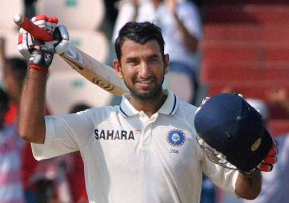 Pujara hits his maiden double ton, Yuvraj  out  for 74