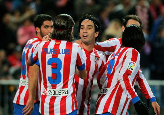 Atletico wins 1-0 at Granada to stay in 2nd place