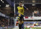 Arsenal beats struggling QPR 2-1 to stay 3rd in EPL
