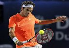 Defending champ Roger Federer wins, Gulbis loses again at Dubai Tennis Championships