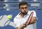 US Open: Gilles Simon upsets 4th-seeded David Ferrer