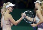 Caroline Wozniacki beats Maria Sharapova at WTA Finals