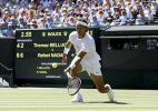 Roger Federer and Rafael Nadal move into second round at Wimbledon