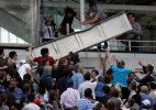 Scoreboard panel falls on spectators in French Open